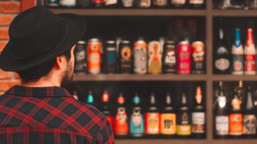 man looking at craft beer selection